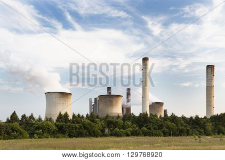 Power Plant Behind Field And Trees