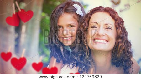 Composite image of mother and daughter smiling