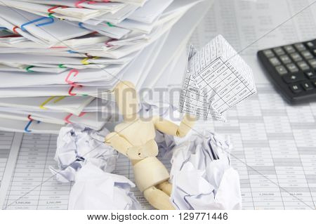 Wooden Dummy Holding Bankruptcy Of House With Blur Paper Ball