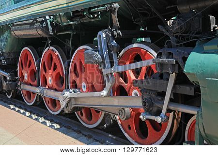 The drive wheels of a steam locomotive closeup