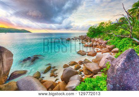 Beautiful sunset over the famous beach Anse Lazio, Praslin island, Seychelles.