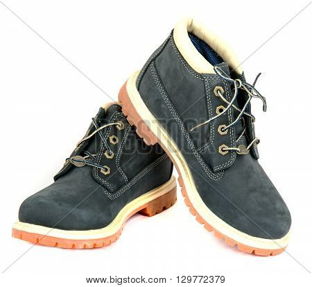 Pair of navy lady's boots with shoelace on white background.