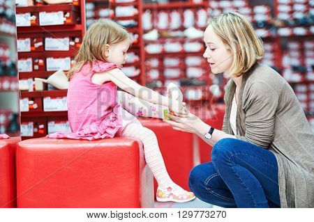 family shopping choosing child footwear shoes