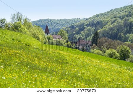 sunny illuminated idyllic rural springtime scenery around Steinkirchen in Hohenlohe a district in Southern Germany
