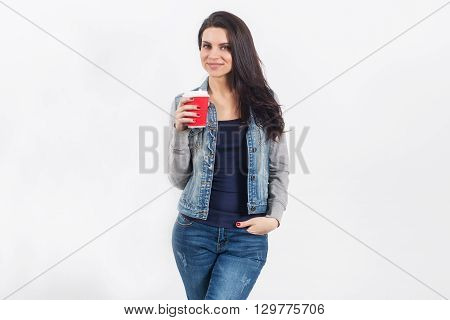 Woman On White Wall With Takeaway Coffee