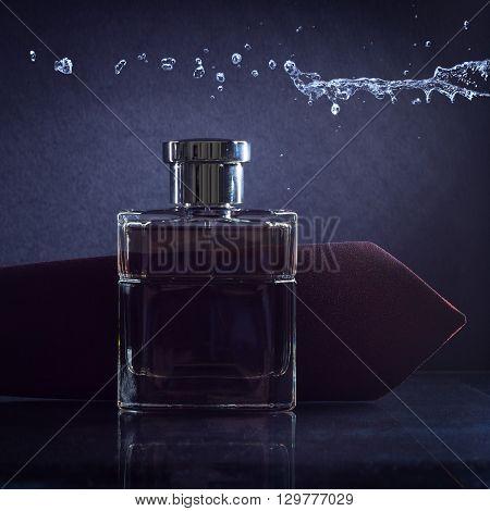 Male perfume bottle on a dark background.