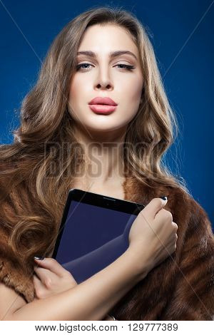 Beautiful girl holding a tablet computer close-up portrait.