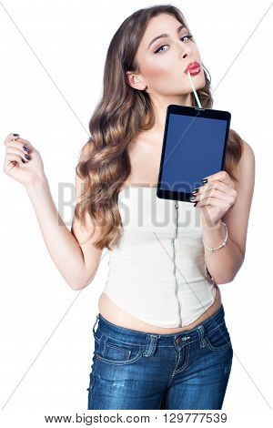 Woman drinking through a straw from a computer tablet.