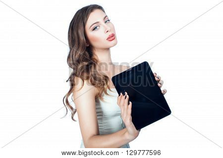 In the hands of a woman tablet computer. On a white background.
