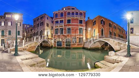 Two bridges and red mansion in the evening Venice Italy