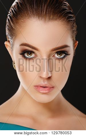 Close up portrait of girl on black background. Evening makeup. Smoky eyes. Hi-end retouch