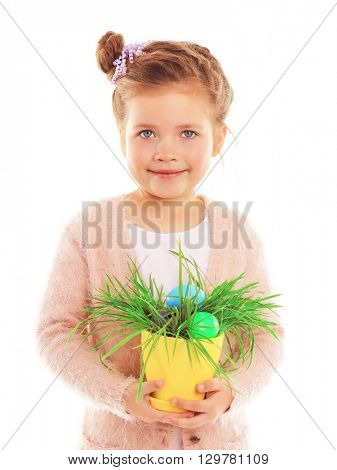 Little girl holding plant with Easter eggs isolated on white
