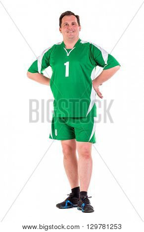 Mature man dressed in green sportswear posing isolated on white background