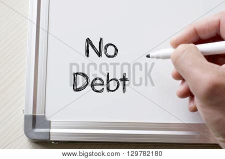 Human hand writing no debt on whiteboard