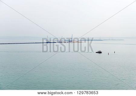 Seascape - Floating cranes on the construction of the bridge Kerch Crimea