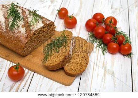 Pieces of homemade bread with tomatoes and dill