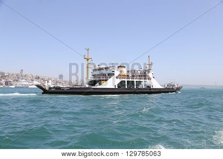 ISTANBUL TURKEY - MAY 14 2016: Istanbul Deniz Otobusleri ferry passing from European to Asian side of Istanbul. 18 ferries in 3 different types carry passengers and vehicles between Sirkeci and Harem.