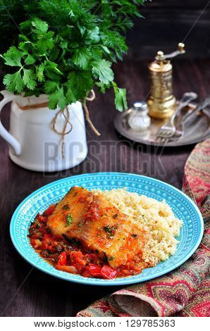 White sea fish cooked in a spicy tomato sauce with sweet pepper, cumin, garlic and coriander.