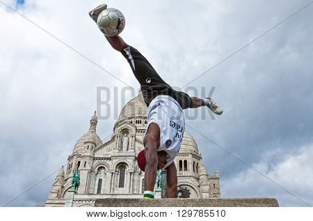 Paris France - October 4 2009: Montmartre a football juggler in front of the Sacre Coeur church.