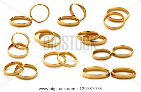 Golden wedding rings isolated on a white collage