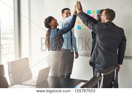 Successful Business Team Giving A High Fives