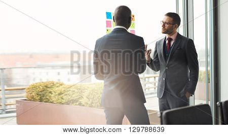 Two Business Executives In An Animated Discussion