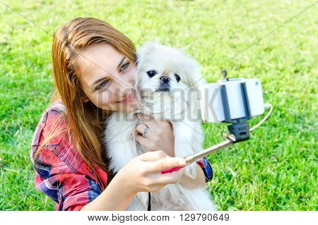 Beautiful girl with dog taken pictures of her self,