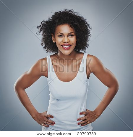 Happy Female Leaning Forward With Hands On Hips