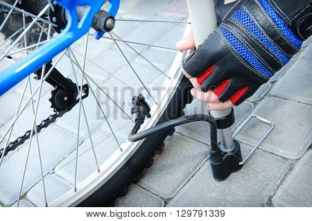 Inflating the tire of a bicycle. Maintenance