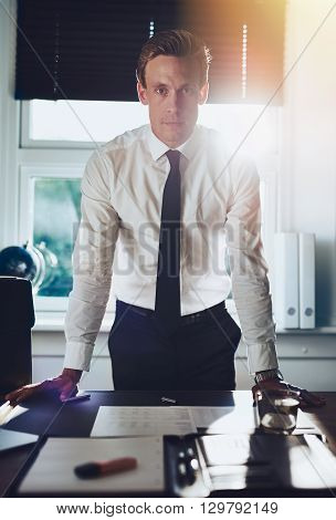 Executive Business Man Standing At Desk At Office
