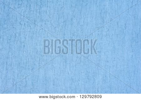 Blue background with white stains. Metal sheet is painted blue, blue paint