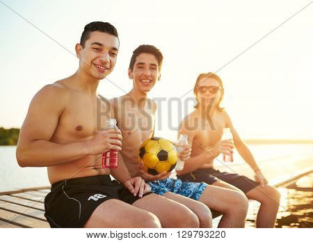 Three Teenage College Students At The Lake