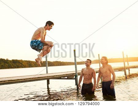 Teenage Boy Jumping Into A Lake