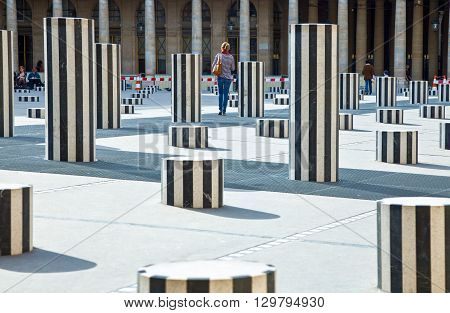 Paris France - August 31 2011: People in the courtyard of the Royal Palace with 'The Columns' of D.Buren.