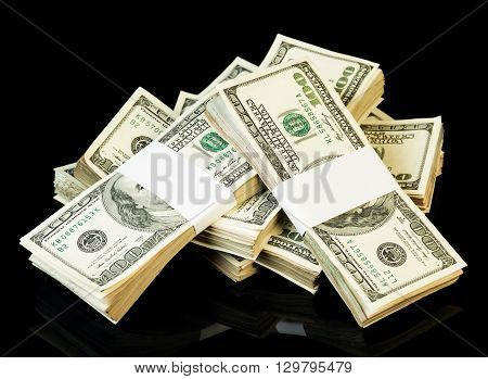 Bundle of dollars isolated on a black background.
