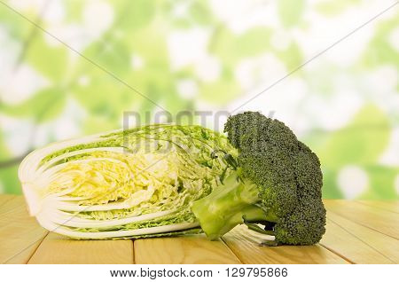Raw broccoli and cabbage isolated on white background.