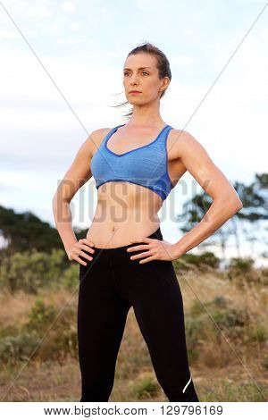 Fit Woman Standing Outside Staring