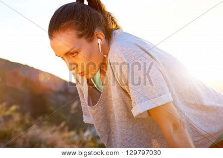 Woman Listening To Music On Earphones After Workout