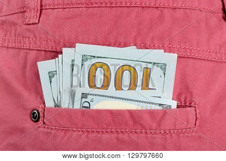 Money in the pink pocket, close up