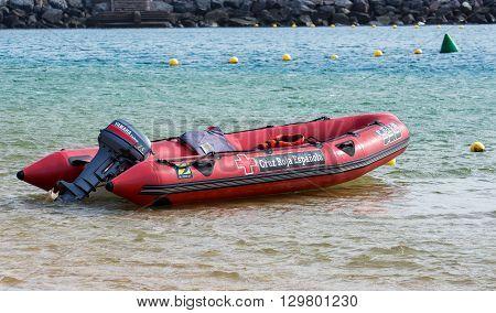 SANTA CRUZ, TENERIFE, SPAIN - DECEMBER 2015: Surf Rescue boat at coast of Teresitas beach on Tenerife island, Spain