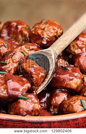 Delicious turkey meatballs in a rich tomato sauce. Extreme shallow depth of field with selective focus.