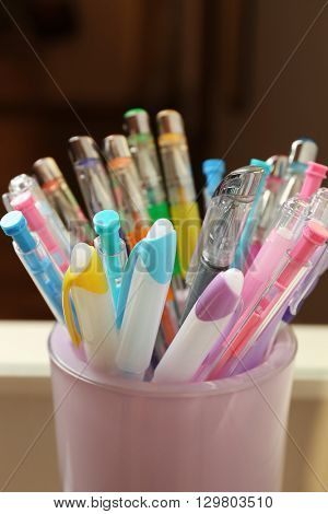 Set of colored pens in glass, close up