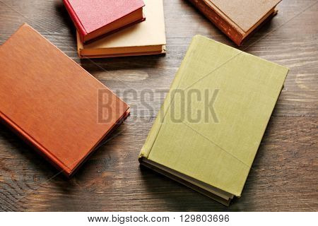 Pile of books on wooden background