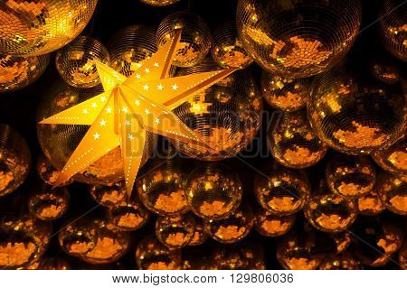 Nightclub orange disco balls and glowing gold star in colorful party lights in dance club, nightlife entertainment industry