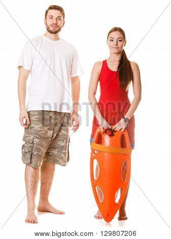 Lifeguards with rescue buoy tube. Man and woman supervising swimming pool. Accident prevention.