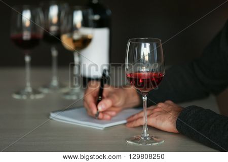 Man tasting new sorts of wine at the table