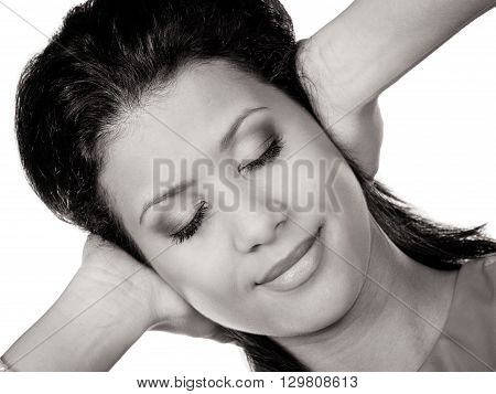 Mixed race woman closing ears with hands protecting from loud noise. Young girl not wanting to hear isolated on white.
