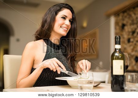 Beautiful woman having dinner in a restaurant