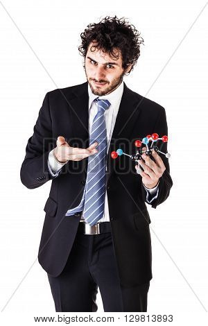 a businessman wearing a suit and a tie holding a trinitrotoluene tnt molecular model isolated over white