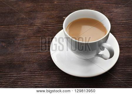 Milk tea on wooden background.